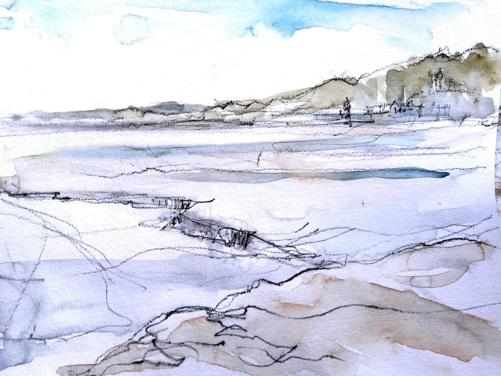 View towards Portmeirion from Ynys Gifftan at low tide on a bright, sunny day