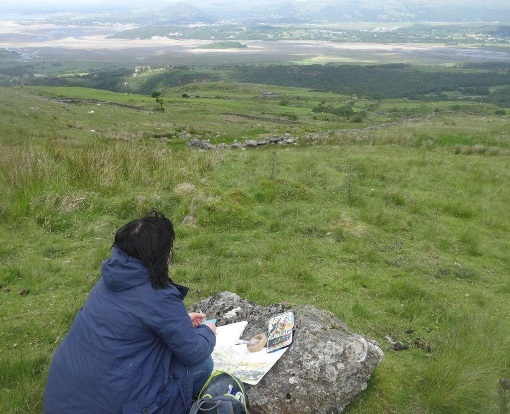Ended up using a well-placed boulder as an easel and anchored the paper down with anything I could as it was very windy up there!