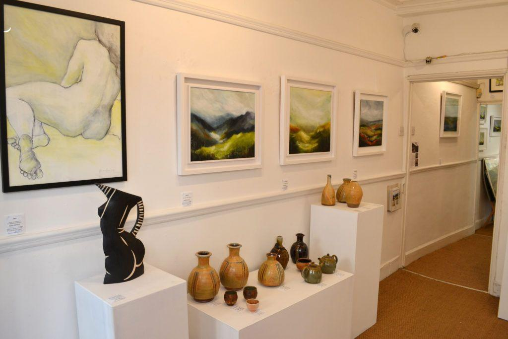 'Sam', 'Pasture', 'Rain Over Littondale' and 'Walking Home' with ceramics by Jude and John Jelfs