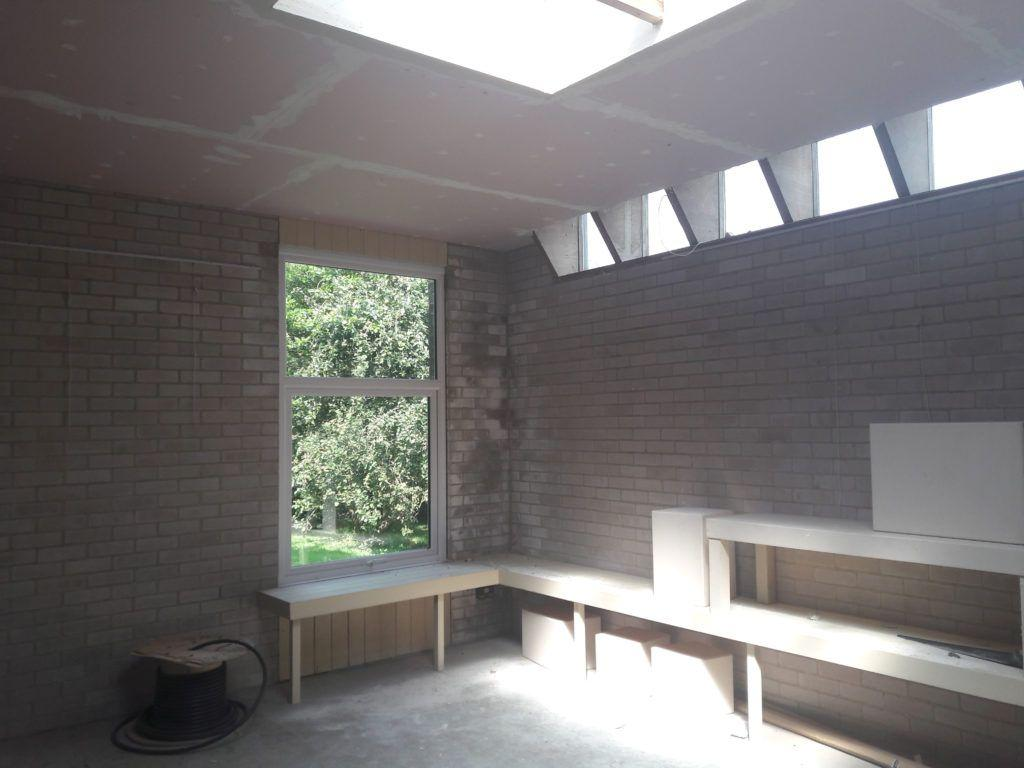 High level north-facing windows and a large roof lantern let in plenty of natural light