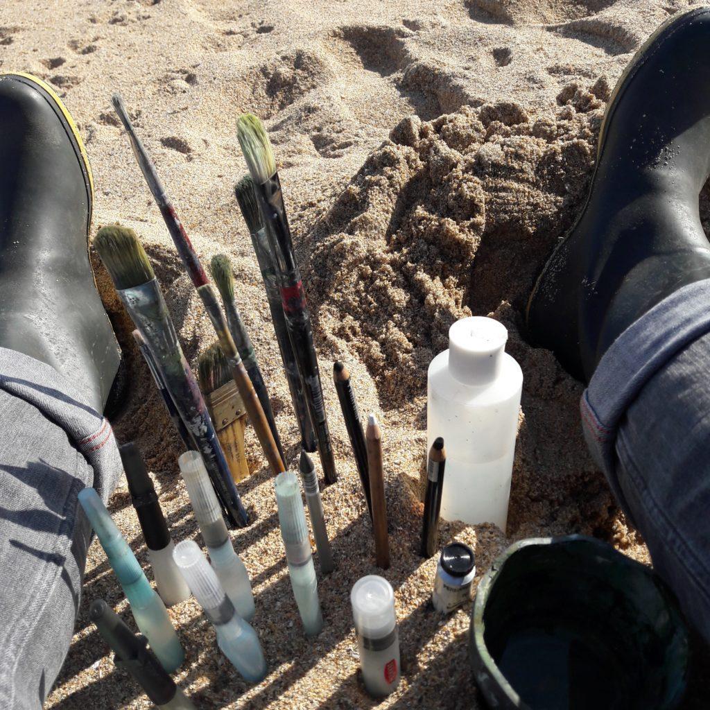 Sand makes an excellent brush holder for working en plein air!