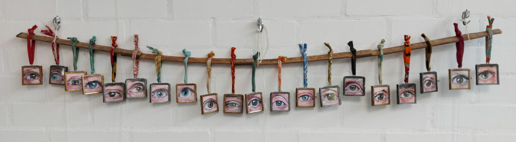 A selection of framed Eye Contact paintings