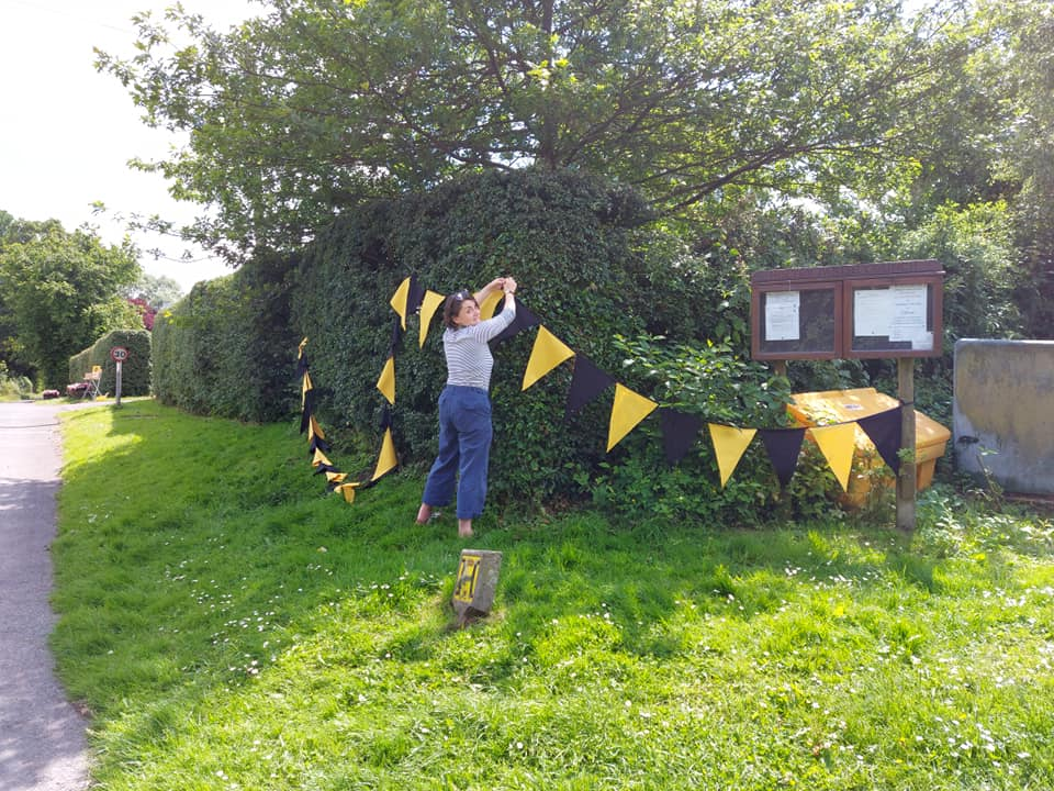 Tabitha putting up the bunting